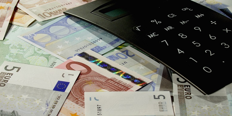 Calculator and Euro Currency --- Image by © Royalty-Free/Corbis
